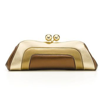 Tiffany & Co. -  Daphne clutch in gold, antique gold and bronze metallic leather.