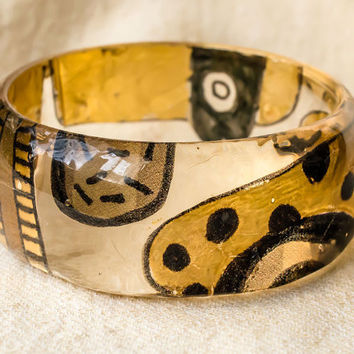Hand Painted Resin Bangle with Gold Paint, Black Stripes and Dots. Thin Transparent Bracelet with Oval Shapes.
