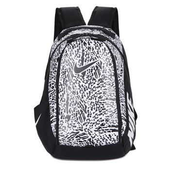 HCXX Nike Graffiti Men's Women's Leisure Sports Travel Backpack 48-35-18cm Black White