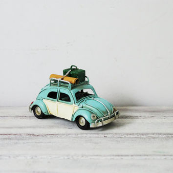 Turquoise, VW bug car miniature, collectible Beetle car with baggage on the rail, shabby, retro blue buggy with white doors , mid nineties