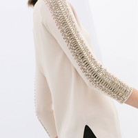 SWEATER WITH RHINESTONES ON THE SLEEVES