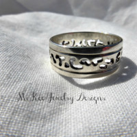 Hand cut argetime silver ring.