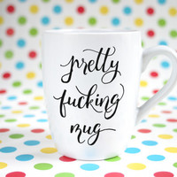"Hand painted mug with mature explicit text ""pretty f***** mug"""