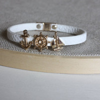 Sweet white bracelet with a gold charm