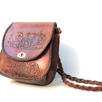 Vintage 1970s chestnut brown leather shoulder bag with floral tooled panels and braided edging