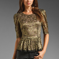BCBGMAXAZRIA Lace Peplum Top in Black/Gold from REVOLVEclothing.com