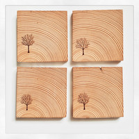 Wood burned tree reclaimed wood coasters. Set of 4 square cedar post coasters with cork backing.