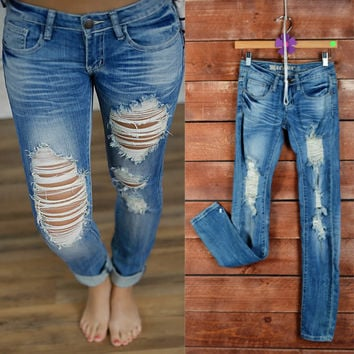 Attractive Rugged Destroyed Jeans (Medium Wash)   Piace Boutique