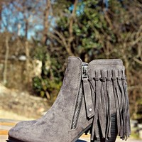 booties with fringe accents around the back.