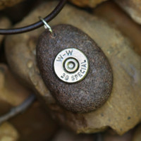 Bullet jewelry, bullet necklace, 38 Special bullet brass set in a Lake Superior stone rock, bullet jewelry