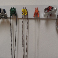 Wooden Dinosaur Necklace or Jewelry Holder by myevilfriend on Etsy