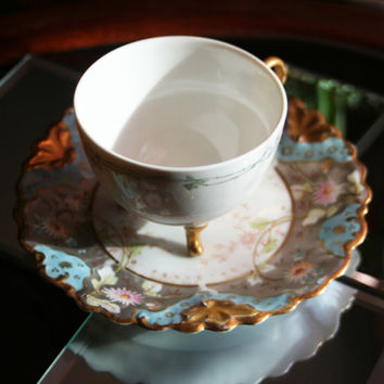 Antique Limoges France Porcelain Hand-Painted Gold Footed Pedestal Tea Cup and Saucer Set