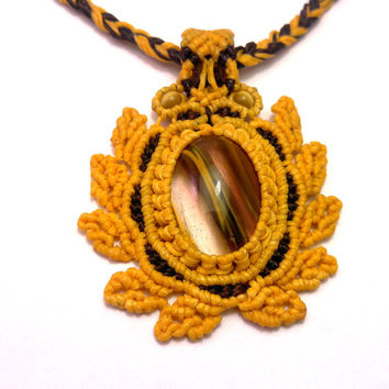 Handmade macrame necklace made with a cherry quartz cabochon and Thai wax cord