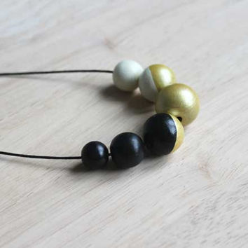 handpainted wooden geometric necklace // simple black, gold, ivory necklace - minimalist and eco-friendly everyday jewelry