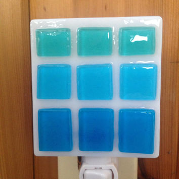 Handmade fused glass nightlight night light with squares and rectangles of beachy turquoise and aqua glass on white background with swivel b