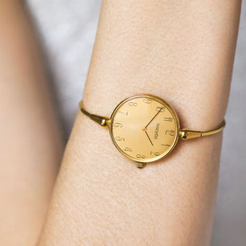 Minimalist woman's watch bracelet Descartes, 80s fashion gold plated watch, cocktail watch rare, unique watch round face, mid size her wrist