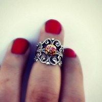 silver and pink fire opal above the knuckle ring