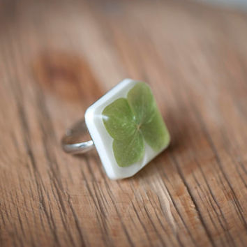 Square ring with a green flower.