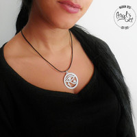 The Eye of Horus round pendant, hand brushed stainless steel, keychain, necklace, egyptian god, spiritualism