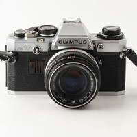 Olympus OM10 35mm SLR Camera with 50mm f1.8 OM Lens & Case | eBay