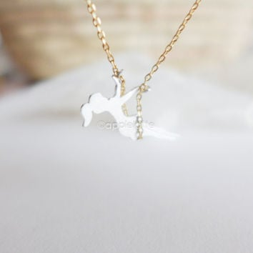 girl on a swing necklace in gold or silver