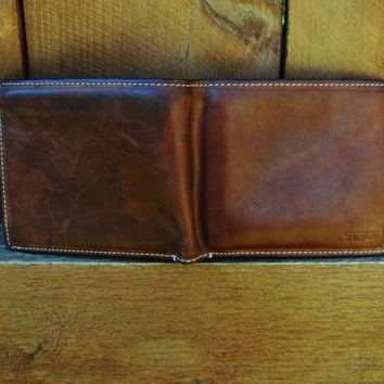 vintage distressed leather TUMI wallet. high quality leather wallet with multiple slots