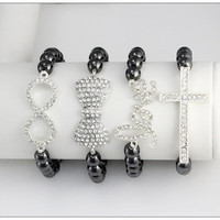 Arm Candy: 4 Piece Crystal Cross Love Infinity & Bow Sideways Fashion Stacked Bracelet Set