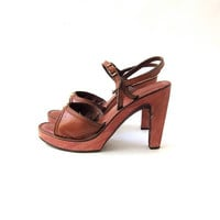 Vintage 1970s leather sandals. super tall platform sandals. wooden heels.