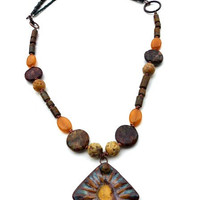 Brown, gold, blue necklace. Ceramic, gemstone, copper jewelry