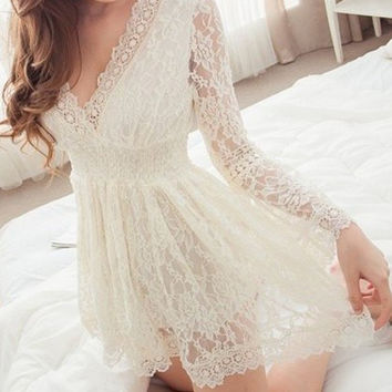 a70d3844703b White Floral Lace V-Neck Mini Dress from Hello Styles