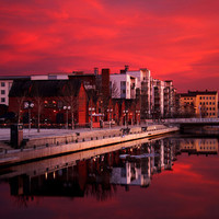 Photo print of red sunset in a city postcard by behindmyblueeyes