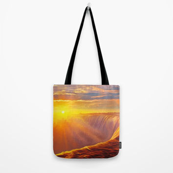 Sunlight waterfall Tote Bag by exobiology