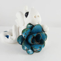 Polymer clay white baby dragon with old blue flower