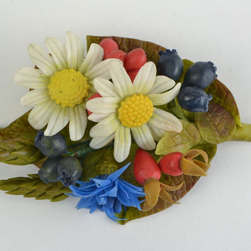 Beautiful bright cold porcelain flower brooch with molded decor