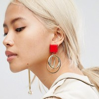 ASOS Interlocking Hoop and Pearl Stick Mismatch Earrings at asos.com
