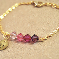 Personalized bracelet with hand stamped initial charm and purple crystal beads, gold plated chain