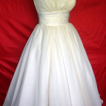 A beautifully elegant off-white 50s inspired wedding dress