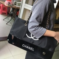 Chanel Trending Women Waterproof Canvas Leather Joining Together Shoulder Bag Environmental Protection Bag