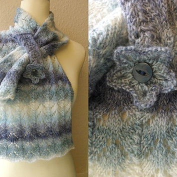 Hand knitted lacy self patterning scarf with pocket.