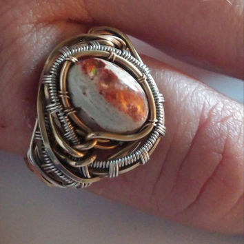 natural fire opal cabochon set in sterling silver and gold wire wrapped ring sz 6