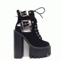Hit the dusty road with this Edgy Abner Cut-Out Ankle Bootie by Jeffrey Campbell! Featuring round toe, cut out design with criss-cross adjustable belt buckle closure, lace up front and rare zipper closure, seriously serious height, perfectly distressed lea