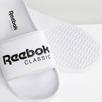 Reebok Classic Logo Sliders In White at asos.com