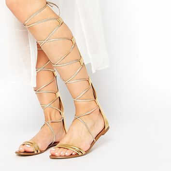 ALDO Umarelle Gold Knee Gladiator Flat Tie Sandals