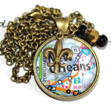 New Orleans Saints necklace, map of New Orleans in a glass pendant with a fleur de lis charm and gold and black beads, Who Dat!
