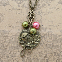 Antique bronze necklace with bird pendant, leaves charm and glass pearl charms