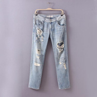 Denim Ripped And Frayed Zippered Pants