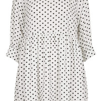 **POLKA BUTTON-CUFF ANGEL DRESS BY THE WHITEPEPPER