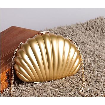 New Arrival.   Ladies Shell Bag/Clutch/Purse.    Available in White, Gold and Black.  Unique and Fun!!   ***FREE SHIPPING***