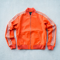 Pharrell Williams x adidas Originals LuxuryTracktop - Orange