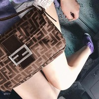 FENDI sells casual ladies' canvas printed one-shoulder baguette bag